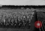 Image of German troops marching on a rough field Germany, 1933, second 28 stock footage video 65675071553