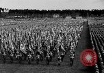 Image of German troops marching on a rough field Germany, 1933, second 29 stock footage video 65675071553
