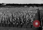 Image of German troops marching on a rough field Germany, 1933, second 30 stock footage video 65675071553