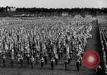 Image of German troops marching on a rough field Germany, 1933, second 31 stock footage video 65675071553