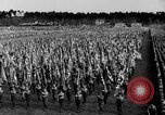 Image of German troops marching on a rough field Germany, 1933, second 32 stock footage video 65675071553