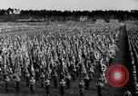 Image of German troops marching on a rough field Germany, 1933, second 33 stock footage video 65675071553