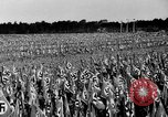 Image of German troops marching on a rough field Germany, 1933, second 35 stock footage video 65675071553