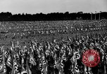 Image of German troops marching on a rough field Germany, 1933, second 36 stock footage video 65675071553