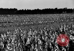 Image of German troops marching on a rough field Germany, 1933, second 37 stock footage video 65675071553