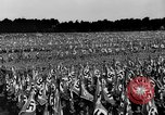 Image of German troops marching on a rough field Germany, 1933, second 38 stock footage video 65675071553