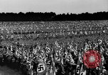 Image of German troops marching on a rough field Germany, 1933, second 39 stock footage video 65675071553