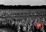 Image of German troops marching on a rough field Germany, 1933, second 40 stock footage video 65675071553