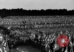 Image of German troops marching on a rough field Germany, 1933, second 42 stock footage video 65675071553