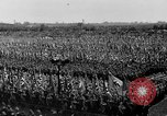 Image of German troops marching on a rough field Germany, 1933, second 43 stock footage video 65675071553