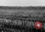 Image of German troops marching on a rough field Germany, 1933, second 46 stock footage video 65675071553