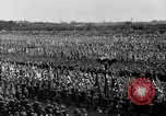 Image of German troops marching on a rough field Germany, 1933, second 47 stock footage video 65675071553