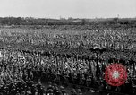 Image of German troops marching on a rough field Germany, 1933, second 48 stock footage video 65675071553