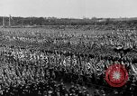 Image of German troops marching on a rough field Germany, 1933, second 49 stock footage video 65675071553