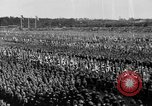 Image of German troops marching on a rough field Germany, 1933, second 50 stock footage video 65675071553