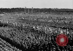 Image of German troops marching on a rough field Germany, 1933, second 51 stock footage video 65675071553