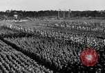 Image of German troops marching on a rough field Germany, 1933, second 52 stock footage video 65675071553