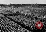 Image of German troops marching on a rough field Germany, 1933, second 53 stock footage video 65675071553