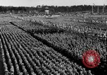 Image of German troops marching on a rough field Germany, 1933, second 54 stock footage video 65675071553