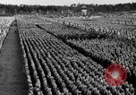 Image of German troops marching on a rough field Germany, 1933, second 55 stock footage video 65675071553
