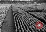 Image of German troops marching on a rough field Germany, 1933, second 56 stock footage video 65675071553