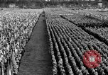 Image of German troops marching on a rough field Germany, 1933, second 57 stock footage video 65675071553