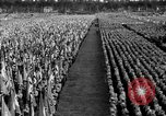 Image of German troops marching on a rough field Germany, 1933, second 58 stock footage video 65675071553