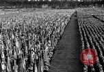 Image of German troops marching on a rough field Germany, 1933, second 59 stock footage video 65675071553