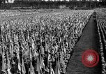 Image of German troops marching on a rough field Germany, 1933, second 60 stock footage video 65675071553