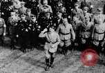 Image of German troops marching on a rough field Germany, 1933, second 61 stock footage video 65675071553