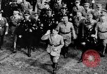 Image of German troops marching on a rough field Germany, 1933, second 62 stock footage video 65675071553
