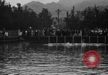 Image of swimming race Hawaii USA, 1916, second 3 stock footage video 65675071572