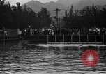 Image of swimming race Hawaii USA, 1916, second 10 stock footage video 65675071572