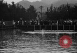 Image of swimming race Hawaii USA, 1916, second 11 stock footage video 65675071572