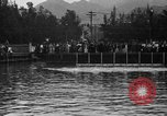 Image of swimming race Hawaii USA, 1916, second 12 stock footage video 65675071572