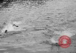 Image of swimming race Hawaii USA, 1916, second 18 stock footage video 65675071572