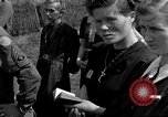 Image of burial service Germany, 1945, second 38 stock footage video 65675071656