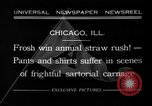 Image of shirts torn off during annual Straw Race Chicago Illinois USA, 1932, second 1 stock footage video 65675071663