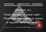 Image of shirts torn off during annual Straw Race Chicago Illinois USA, 1932, second 2 stock footage video 65675071663