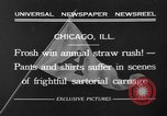Image of shirts torn off during annual Straw Race Chicago Illinois USA, 1932, second 3 stock footage video 65675071663