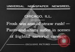Image of shirts torn off during annual Straw Race Chicago Illinois USA, 1932, second 13 stock footage video 65675071663
