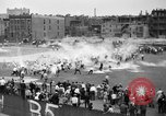 Image of shirts torn off during annual Straw Race Chicago Illinois USA, 1932, second 24 stock footage video 65675071663
