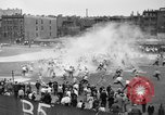 Image of shirts torn off during annual Straw Race Chicago Illinois USA, 1932, second 28 stock footage video 65675071663
