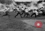 Image of shirts torn off during annual Straw Race Chicago Illinois USA, 1932, second 30 stock footage video 65675071663