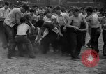 Image of shirts torn off during annual Straw Race Chicago Illinois USA, 1932, second 35 stock footage video 65675071663
