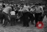 Image of shirts torn off during annual Straw Race Chicago Illinois USA, 1932, second 36 stock footage video 65675071663