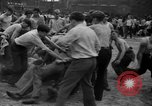Image of shirts torn off during annual Straw Race Chicago Illinois USA, 1932, second 39 stock footage video 65675071663