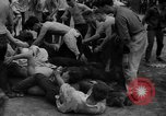 Image of shirts torn off during annual Straw Race Chicago Illinois USA, 1932, second 42 stock footage video 65675071663