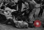 Image of shirts torn off during annual Straw Race Chicago Illinois USA, 1932, second 43 stock footage video 65675071663