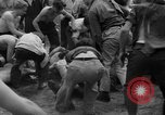 Image of shirts torn off during annual Straw Race Chicago Illinois USA, 1932, second 48 stock footage video 65675071663